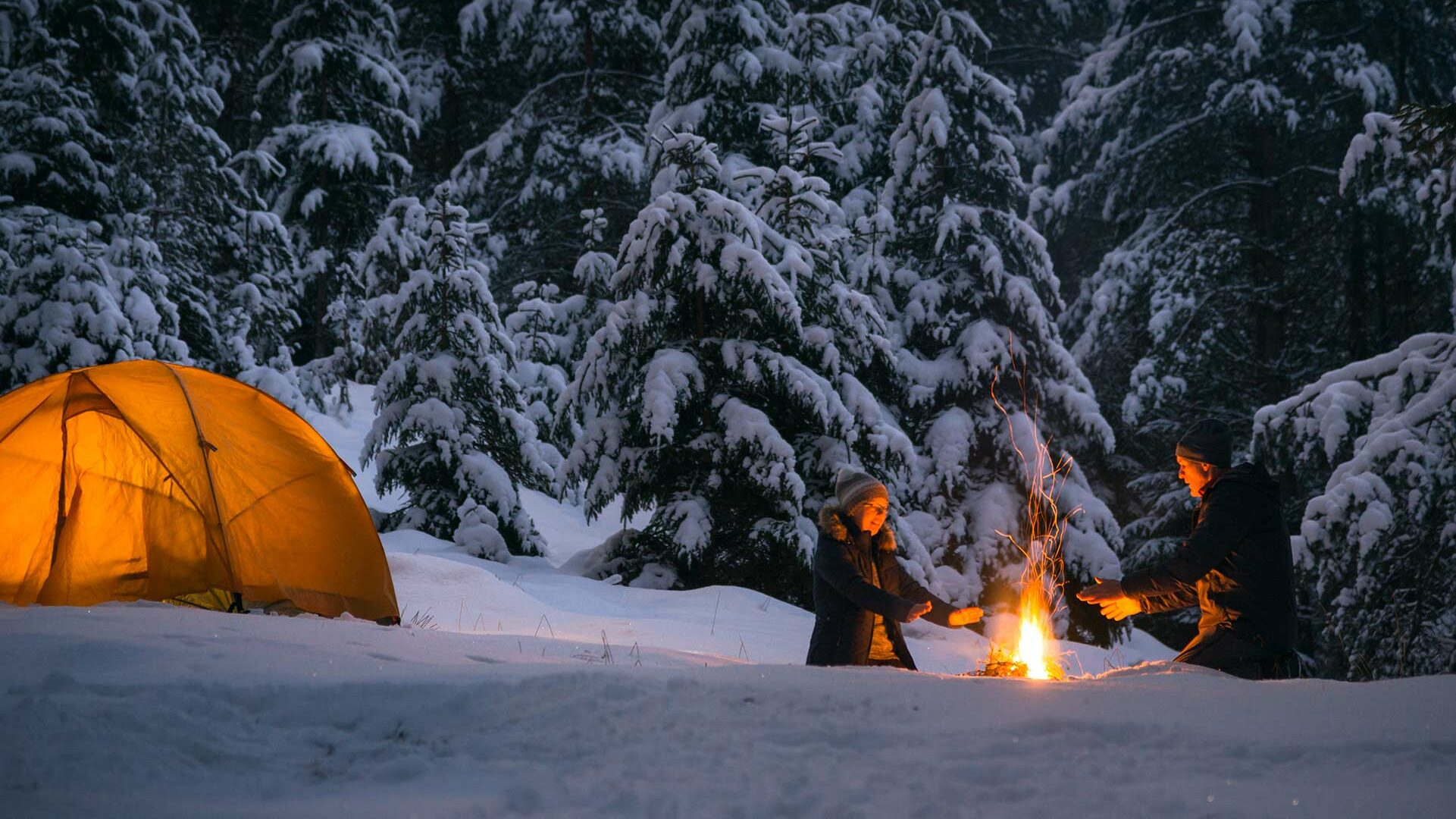 two people camping in woods