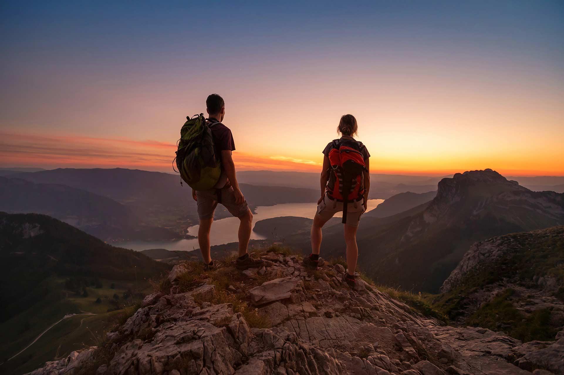 two people overlooking mountain range